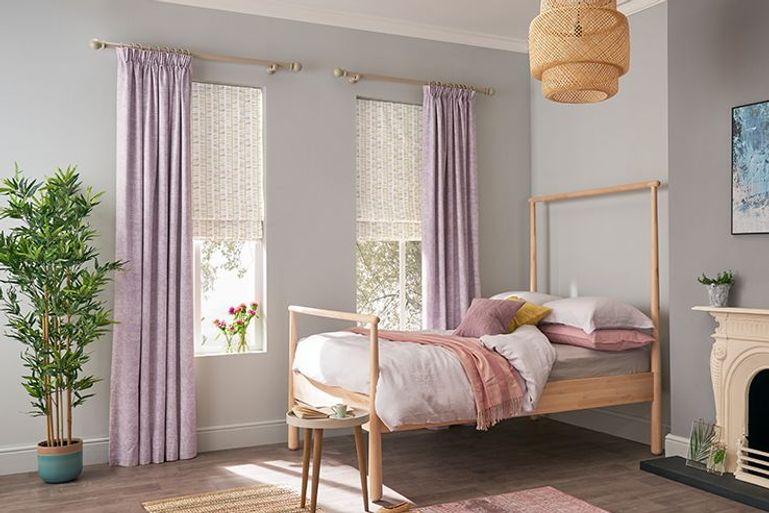 Bedroom with curtains in soft purple fabric