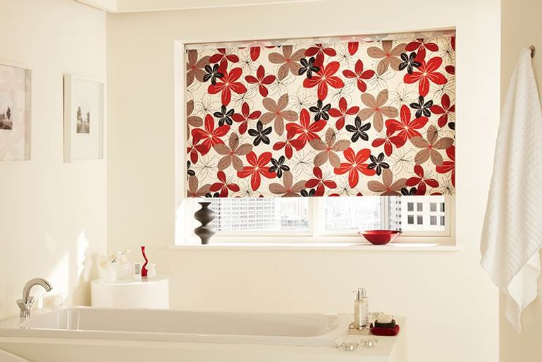 bright flowery patterned roller blind in a bathroom window