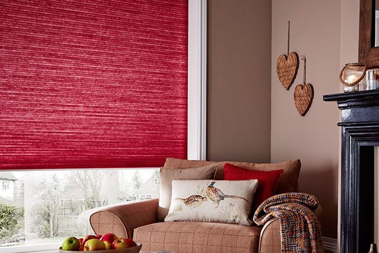 cosy living room with warm red pleated blinds at the window
