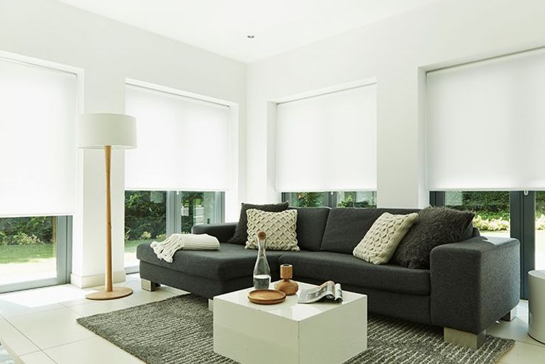 bright white roller blinds in a contemporary styled living room