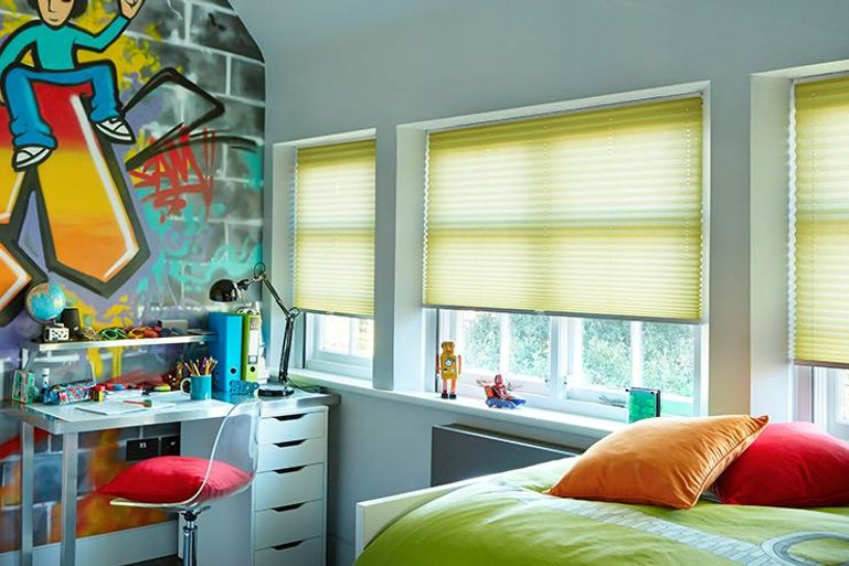 colourful children's bedroom with a wall mural and bright yellow pleated blinds