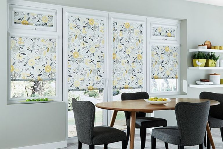 white roller blinds with yellow printed flower detail