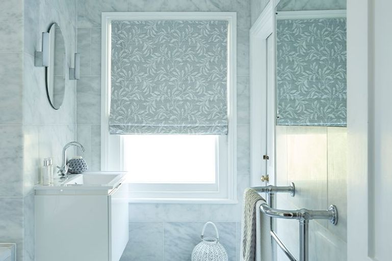 silver grey roman blinds in a bathroom window