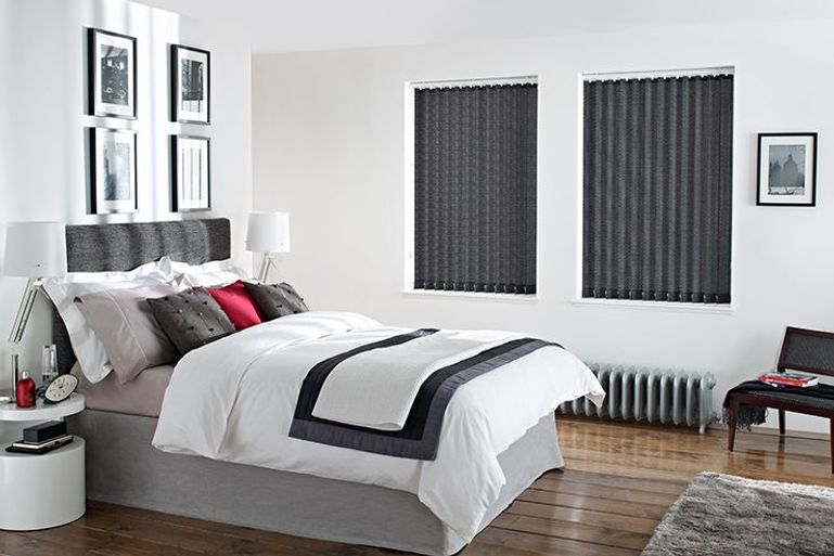 monochrome bedroom with black vertical blinds