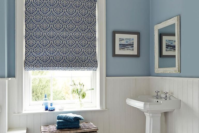Kashmir porcelain blue and white blackout roman blinds in a bathroom window