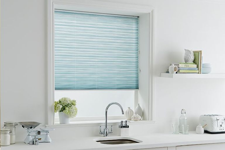 light blue pleated blinds in a kitchen window