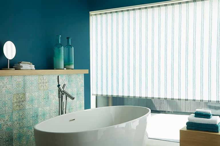 stripey blue roller blinds in a bathroom window