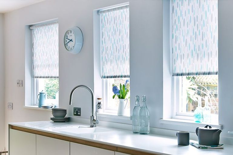 light blue roller blinds in a kitchen window