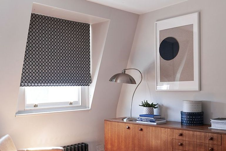 denim blue roman blind in bedroom window
