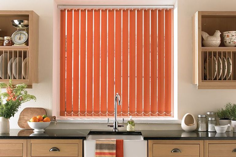 modern farmhouse kitchen with warm orange vertical blinds