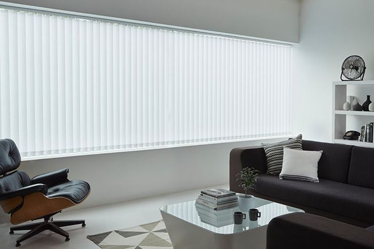 modern minimalist living room with white vertical blinds