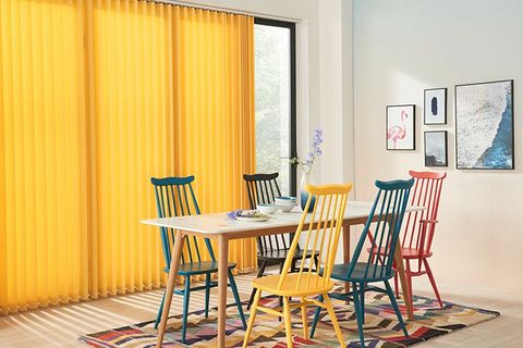 modern colourful dining area with floor length yellow vertical blinds