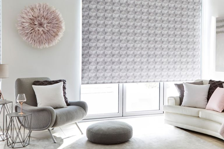 House Beautiful portrait grey roller blind in a living room window