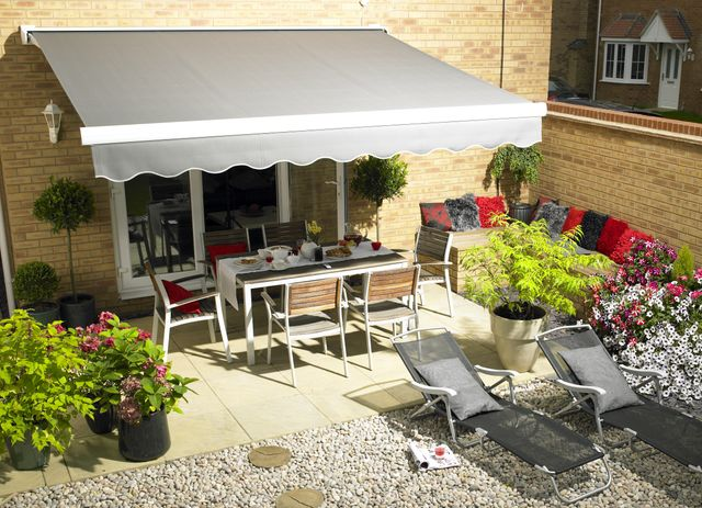 Grey awning overlooking patio furniture