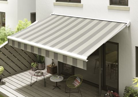 Grey striped awning overhanging a wooden patio