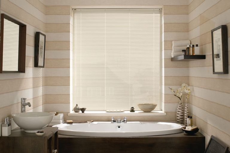 cream blinds in a bathroom window