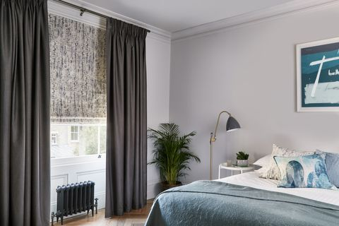 Relaxing bedroom with luxury grey pattern roman blinds