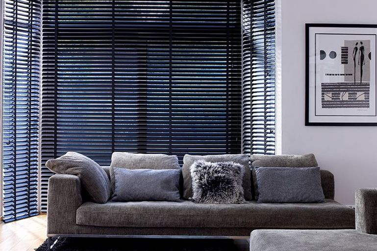 luxury grey living room with black venetian blinds