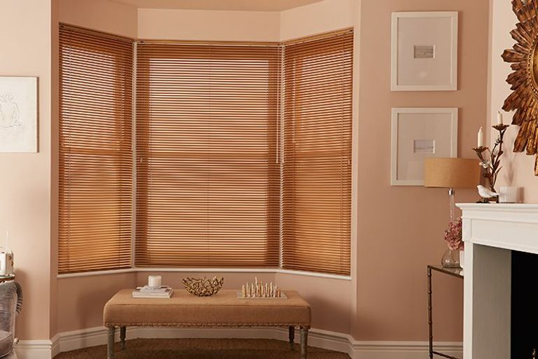 warm and cosy living room with brown venetian blinds