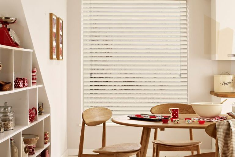 dining room with wooden furniture and light cream venetian blinds