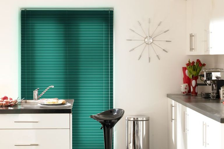 kitchen dining area with full length window dress with green venetian blinds