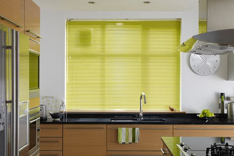kitchen window with lime green venetian blinds and matching accessories