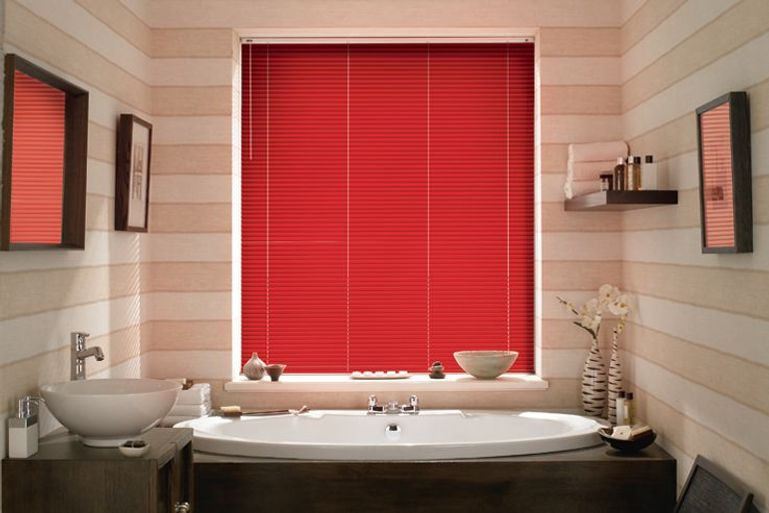 modern bathroom with warm red venetian blinds