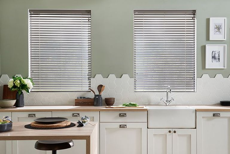 kitchen with neutral decor and grey venetian blinds above the sink