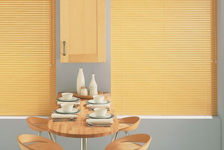 modern scandi dining area with warm yellow venetian blinds