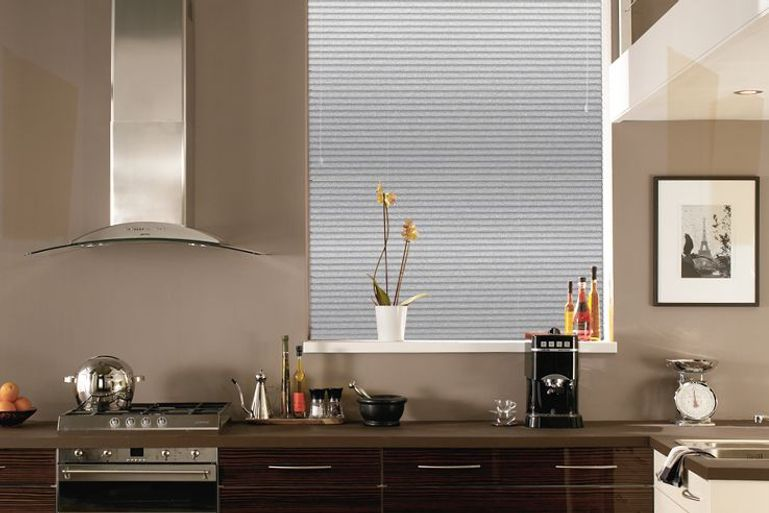 modern kitchen with large window dressed with silver venetian blinds