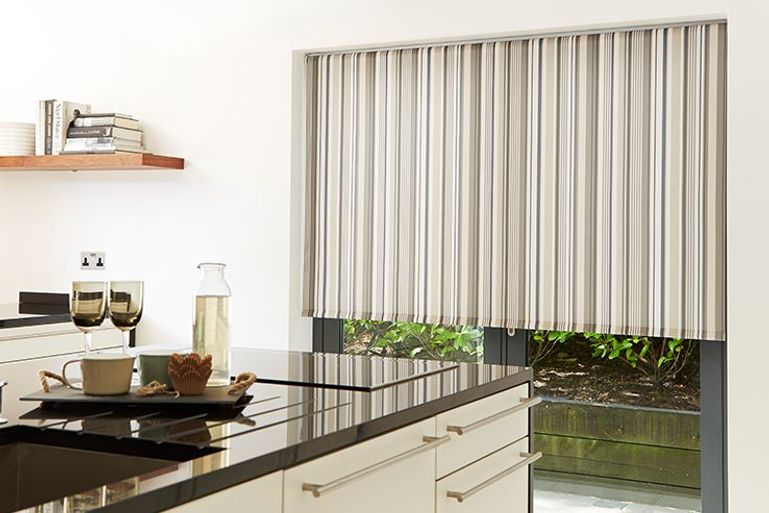 striped grey roller blinds in a kitchen window