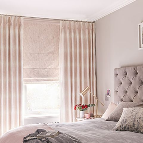 Soft Pink Curtains in Serenity Blush Fabrics paired with Pink Roman Blinds in a chic boutique bedroom