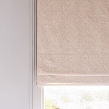 Light pink roman blind close up