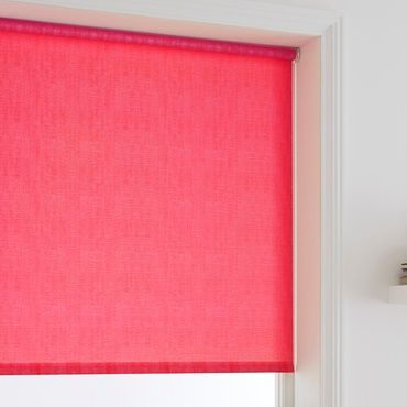 close up of pink roller blinds