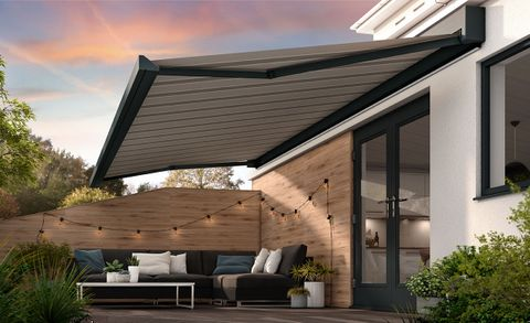 An extended awning in Manosque Dark Grey fabric covering a outdoor area