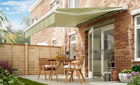 An extended awning in Pencil Green fabric covering a outdoor area
