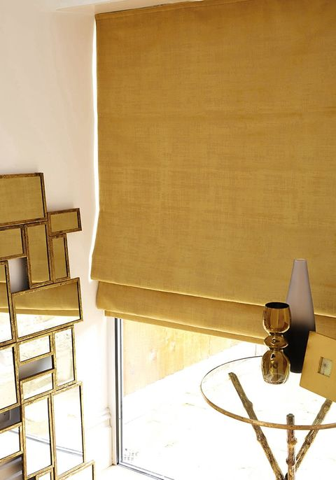 Gold luxe living room decor with matching blackout Roman blinds