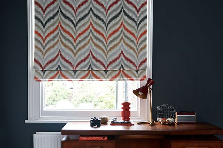colourful stripey souk spice roman blind in a home office window