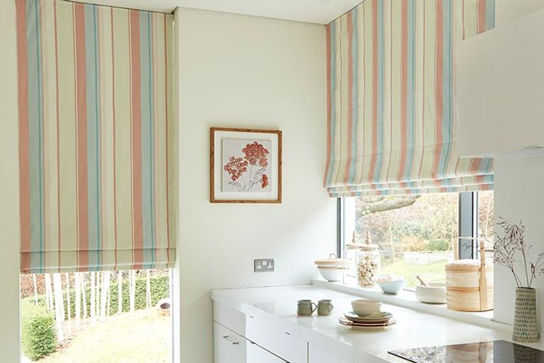 colourful striped roman blinds in a kitchen window