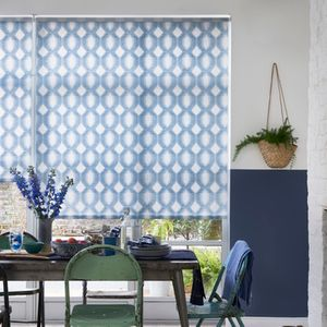 Groovy geometric printed blue and white roller blinds in a dining room