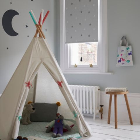 Twinkle Star Grey Roller Blind in a Children's Bedroom with Play Tent and toys