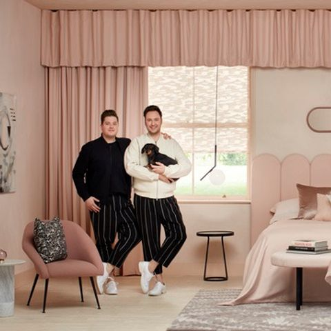 Pink velvet curtains over pink roman blinds in bedroom of Interior design team Jordan and Russell
