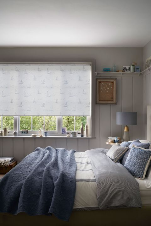 Patterned Boats Navy roller blind hung in bedroom