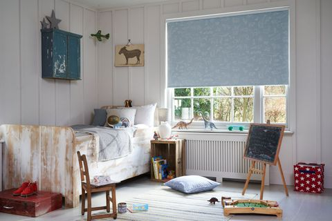 Blue Patterned Brooklyn Denim Drift roller blind hung in bedroom