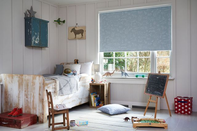 Child's bedroom with a light Blue Patterned roller blind