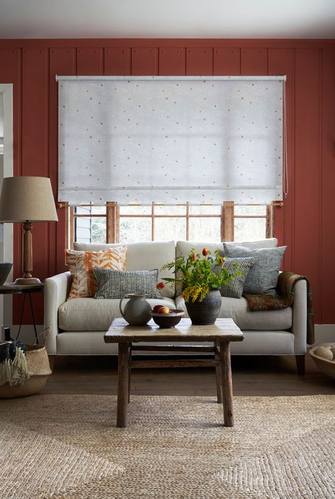 Cosy rustic living room with orange Leaf pattern roller blinds