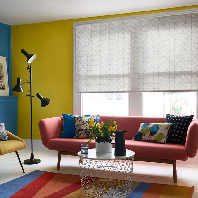 Patterned Cosmic Blue Mist roller blind hung in living room