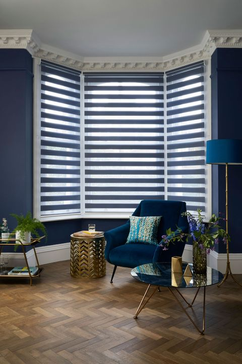 Denim Blue Enlight™ Roller Blind hung in living room