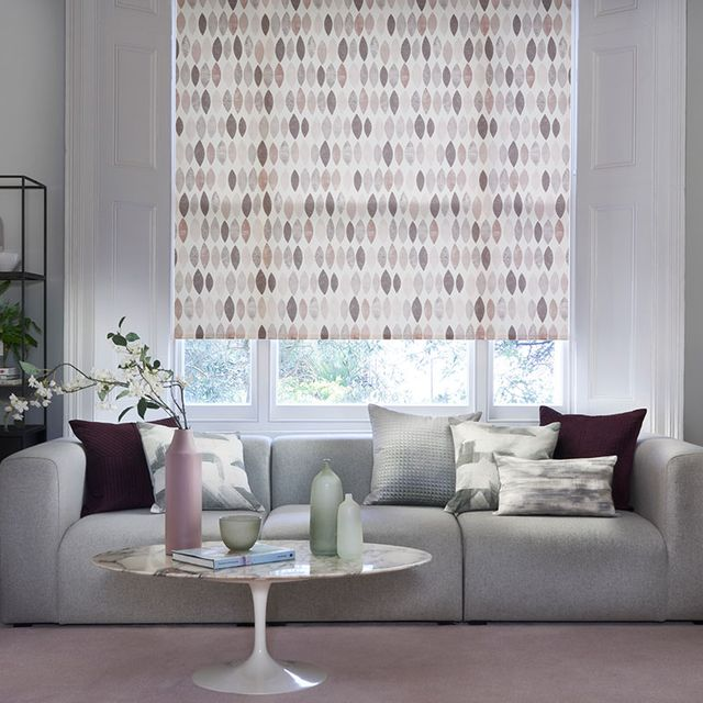 Pink and Grey Patterned Dove Blush roller blind hung in living room