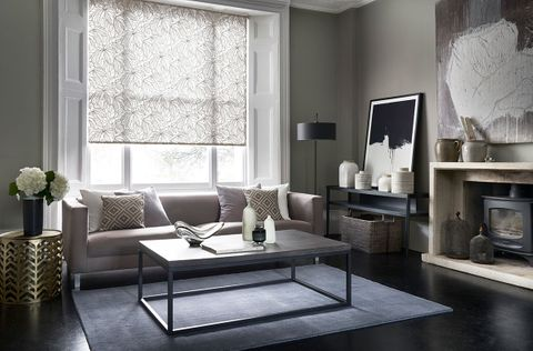 Formal living room with a grey floral roller blind